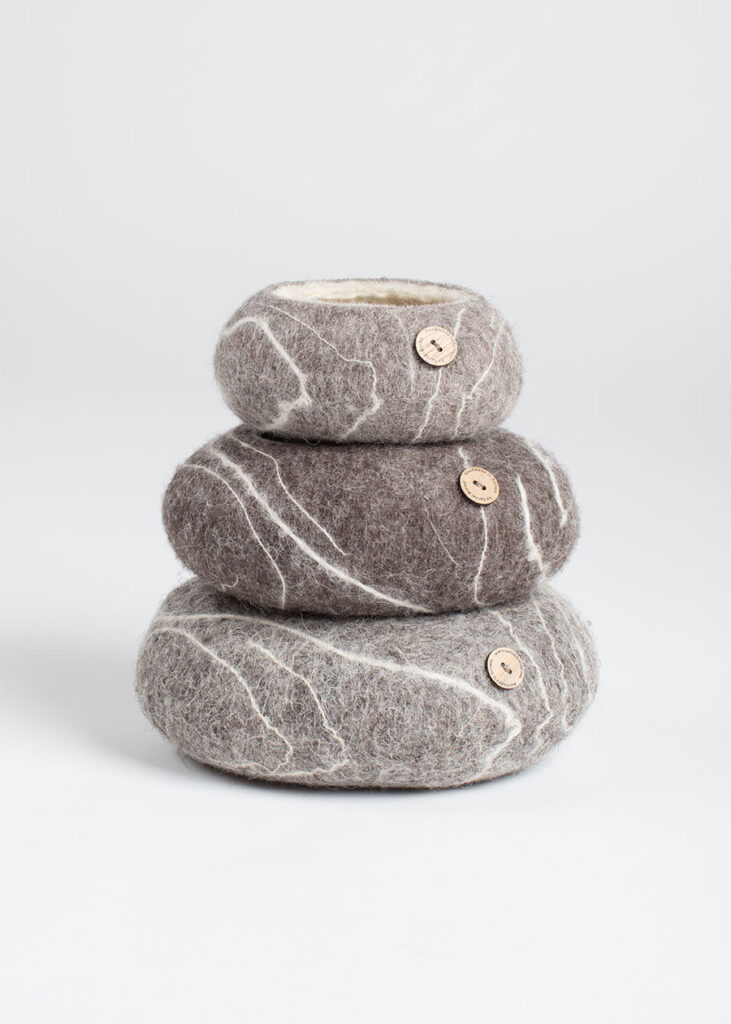 Three Pebble Bowls stacked up for fun, showing the three different sizes and the branded button.